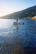Standing on the jetty with the dog