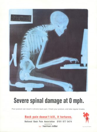 Spinal Damage Poster from the National Back Pain Association, showing a skeleton at a desk - he should have gone to Posture Clinic!