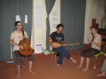 Three musicians and their instruments thinking and playing